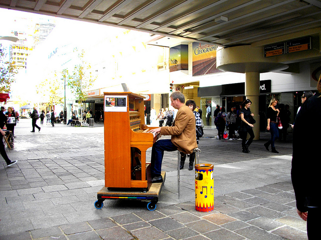 John Gill playing his piano in the Murray Street Mall.