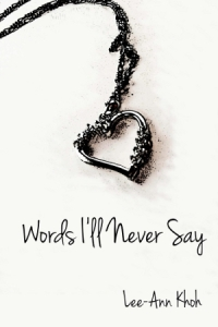 Words I'll Never Say cover featuring a heart necklace.
