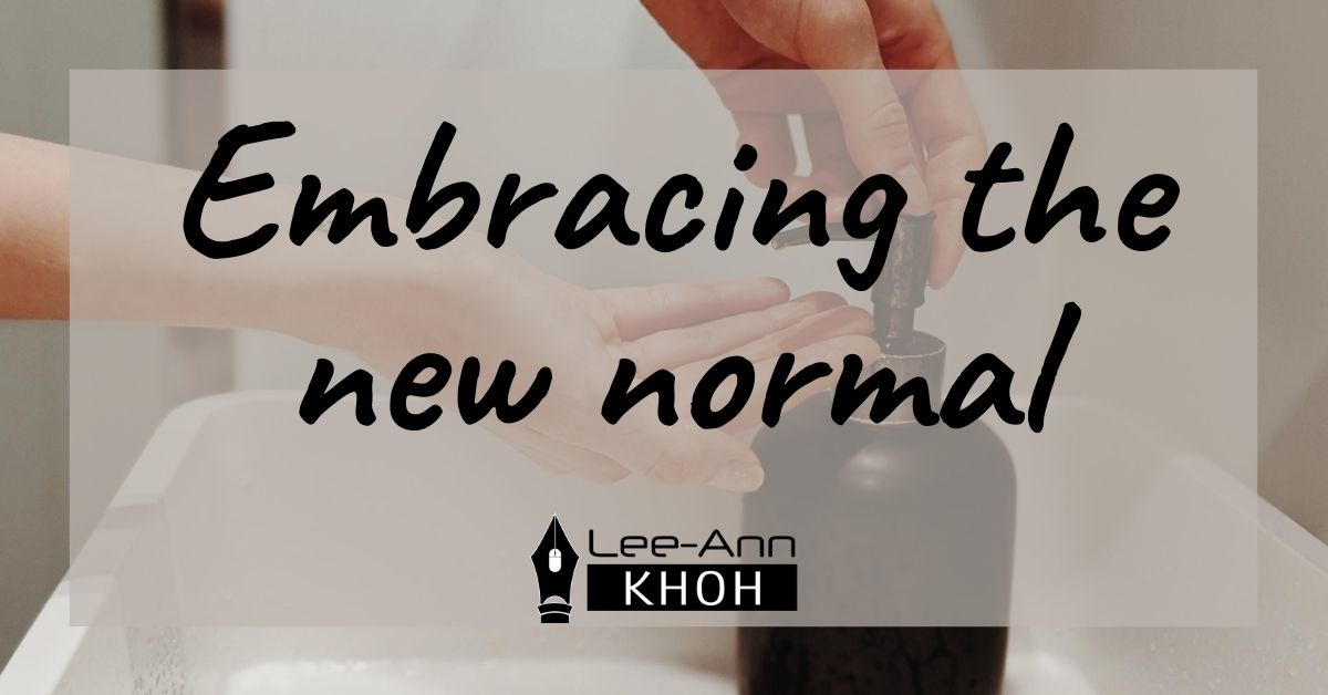 Text reads: Embracing the new normal. Background contains a pair of hands pumping liquid soap at a sink.