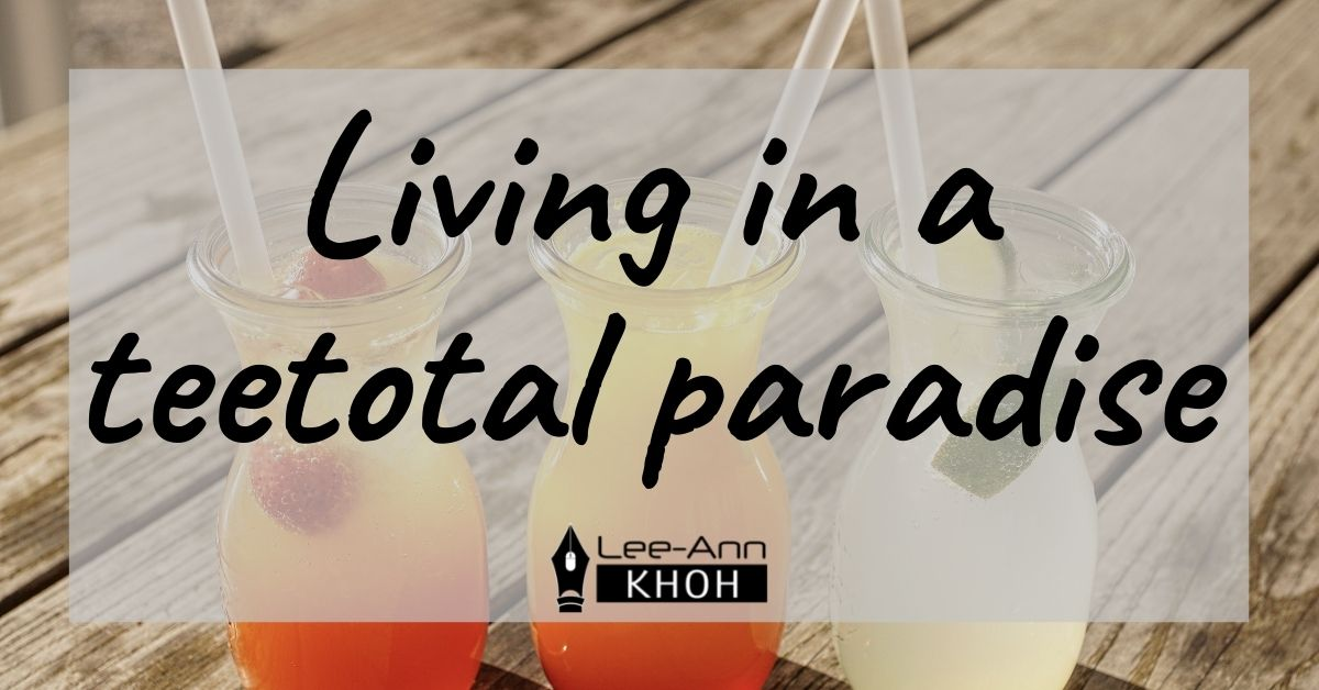 Text reads: Living in a teetotal paradise. Background contains 3 colourful cocktails in glasses.