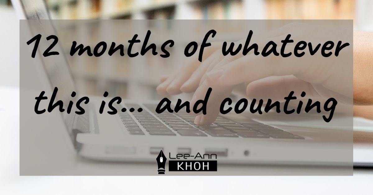 Text reads: 12 months of whatever this is... and counting. Background contains fingers typing on laptop keyboard.